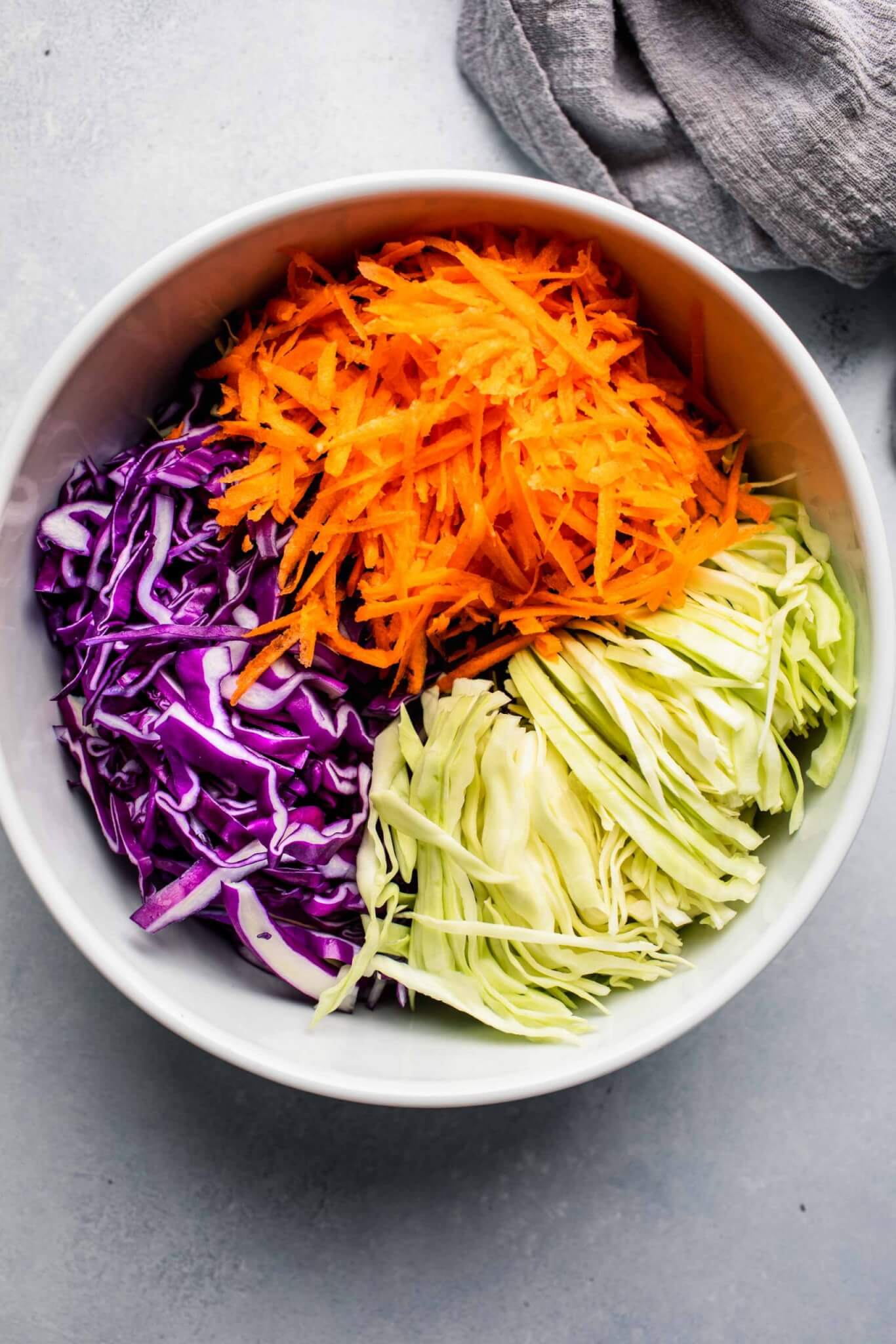 Shredded cabbage and carrots in large mixing bowl.
