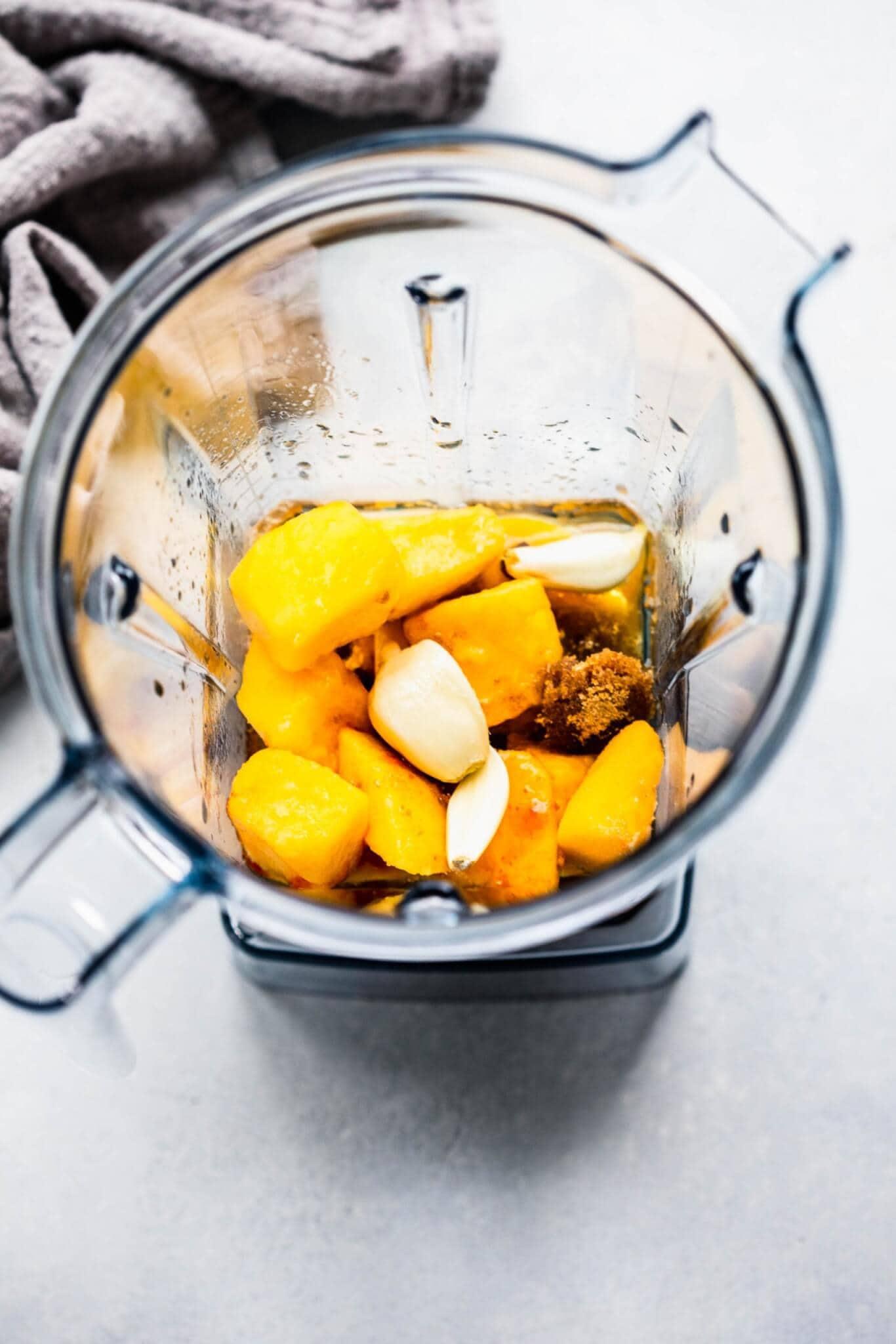 Ingredients for mango marinade in blender