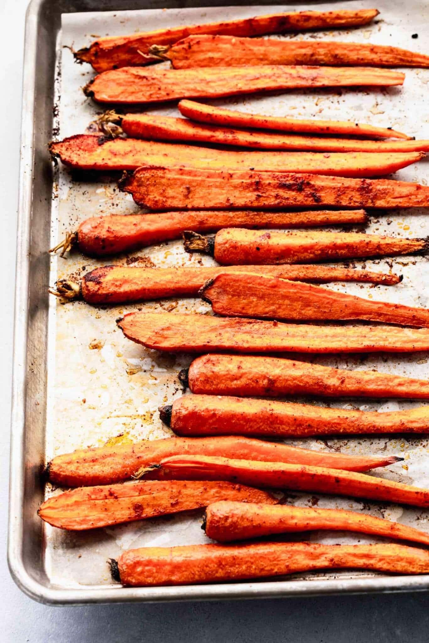 Oven roasted carrots on baking sheet.