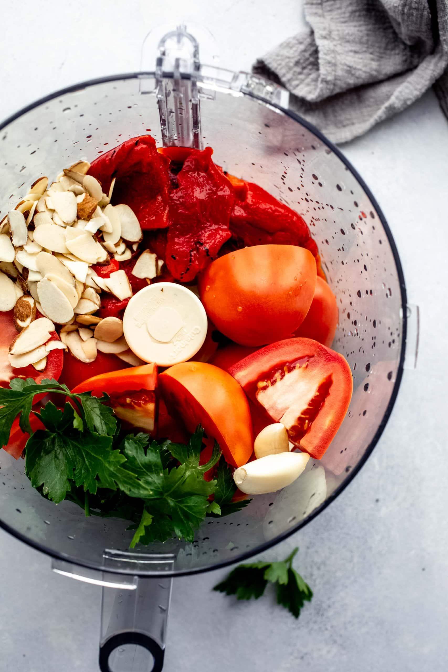 Ingredients for romesco sauce in food processor.