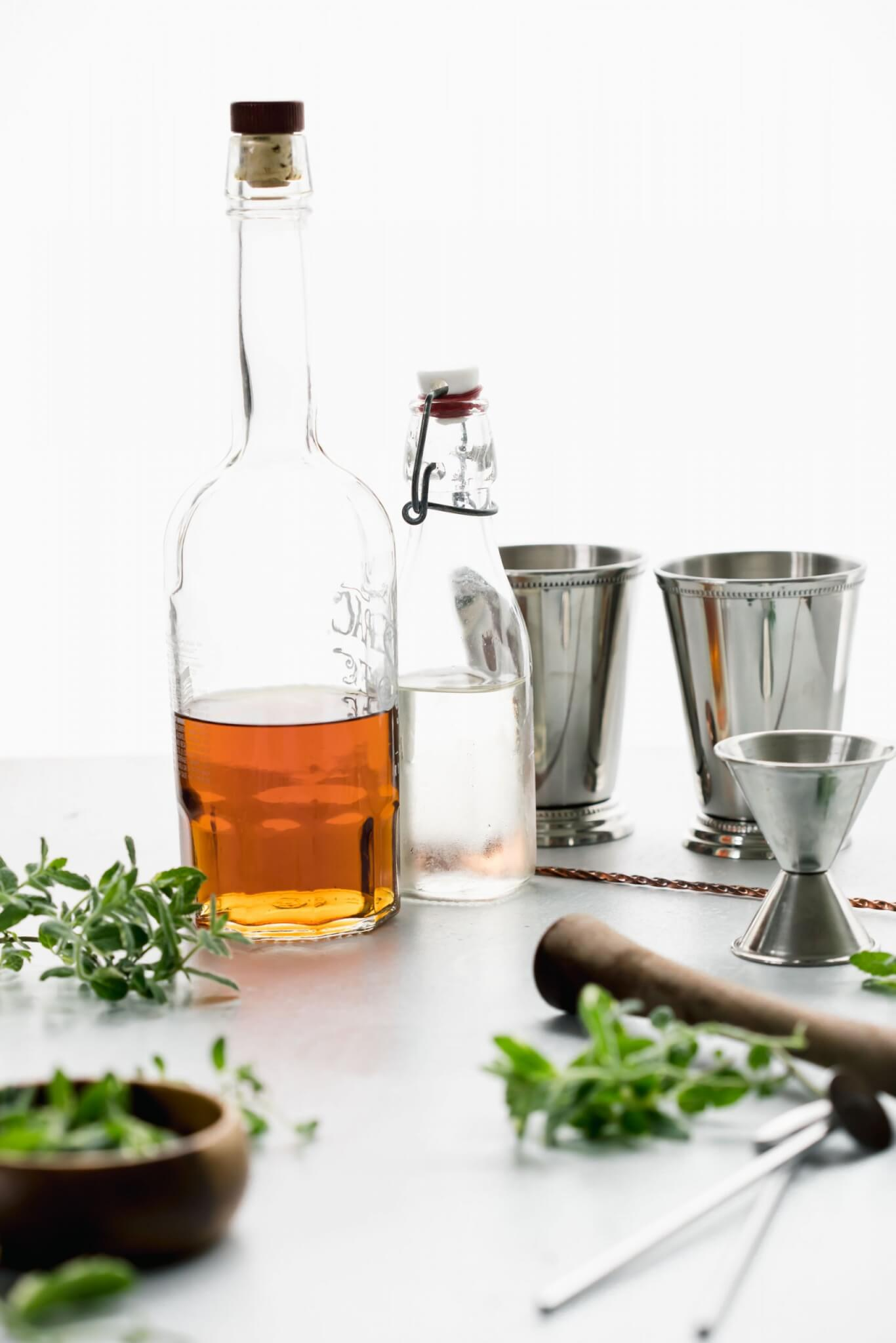 Ingredients for mint julep recipe laid out on countertop