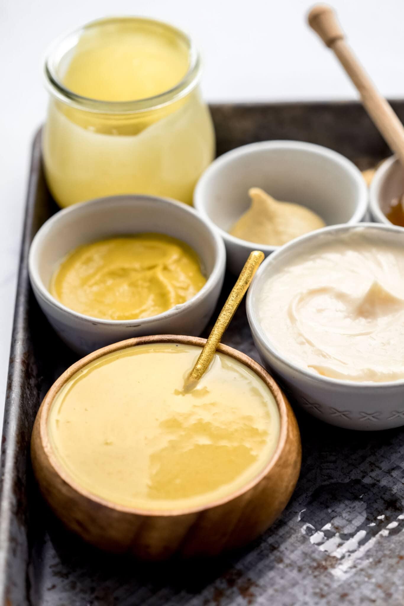 Ingredients for honey mustard laid on baking sheet