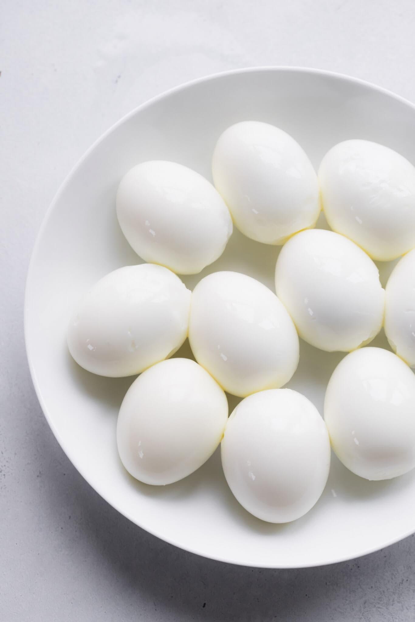 Bowl of peeled hard boiled eggs