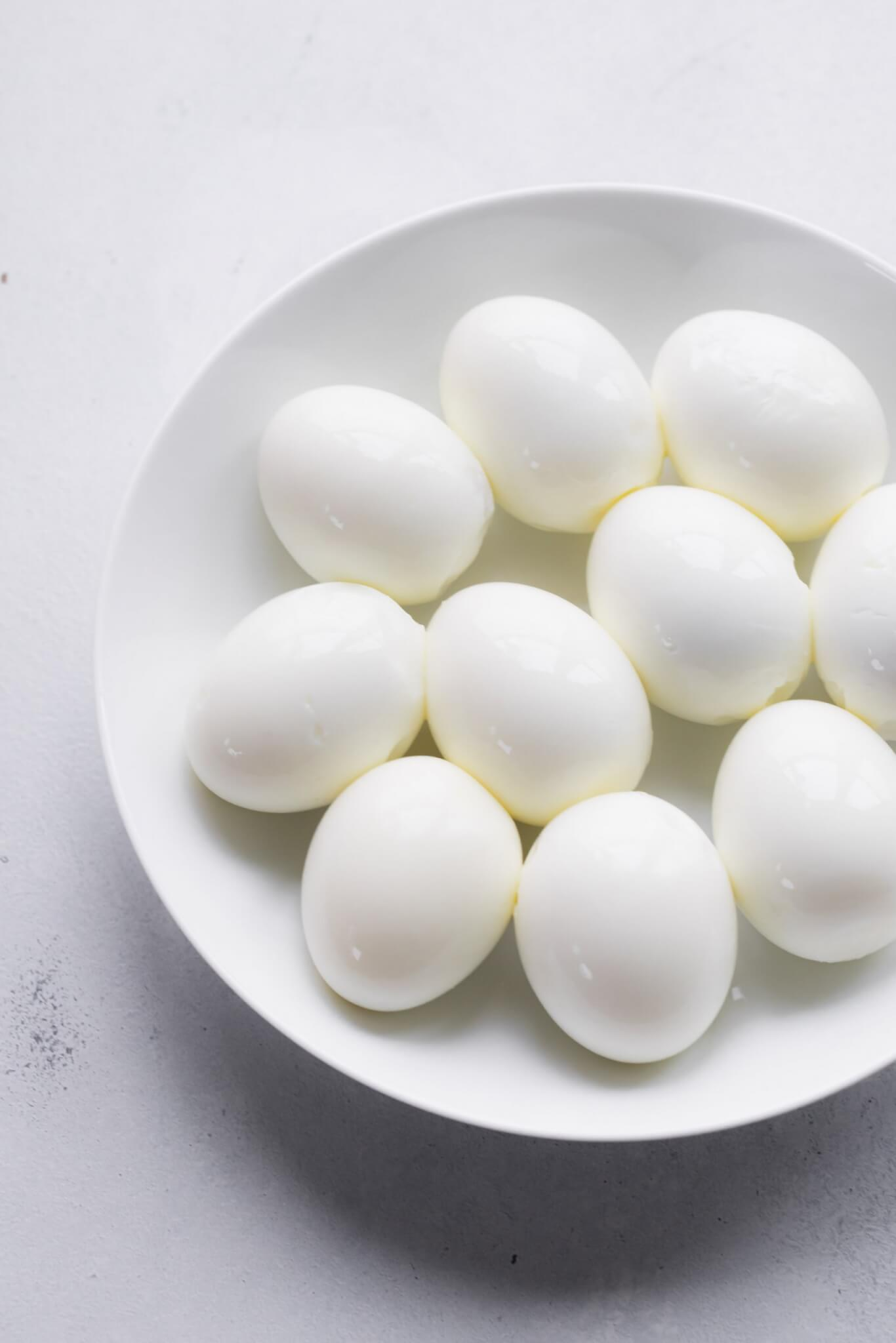 Bowl of peeled hard boiled eggs.