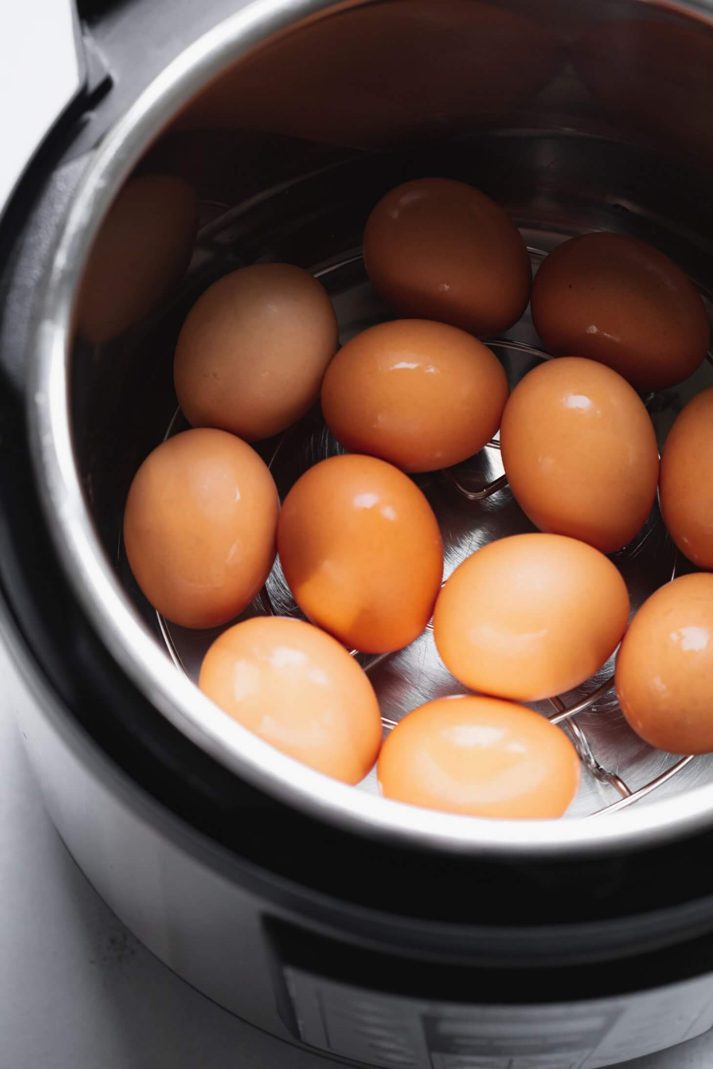 Eggs in the instant pot on a metal trivet.