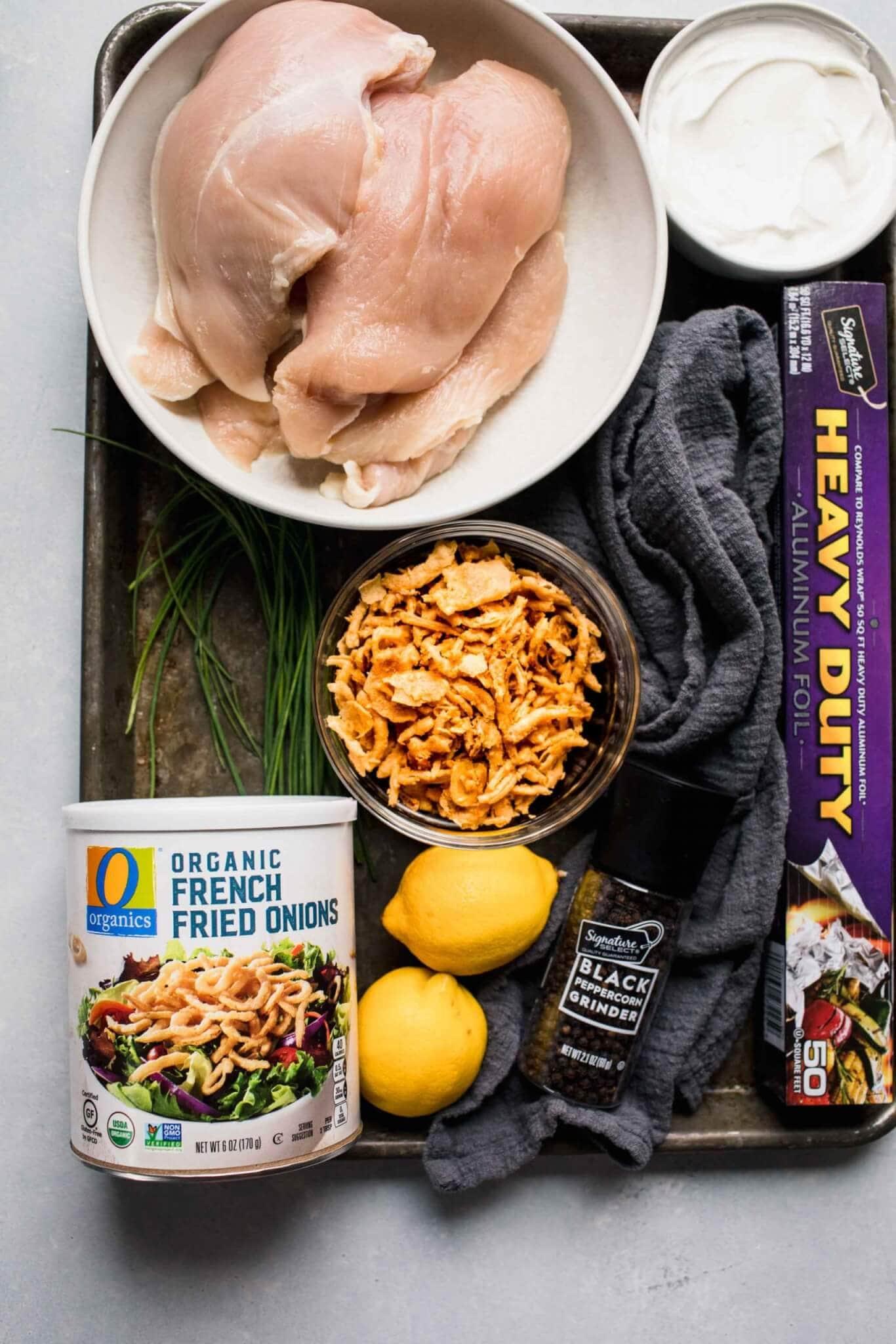 Ingredients for crispy baked chicken on baking sheet.