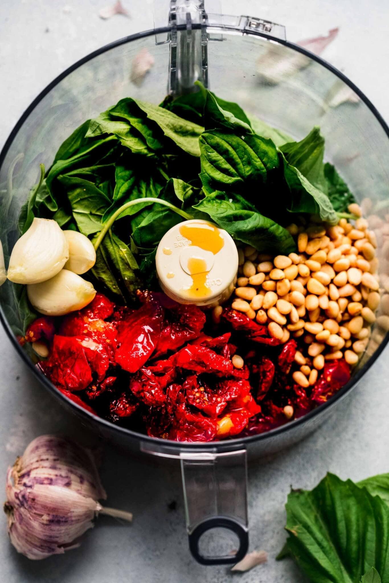 Ingredients for tomato pesto in food processor.