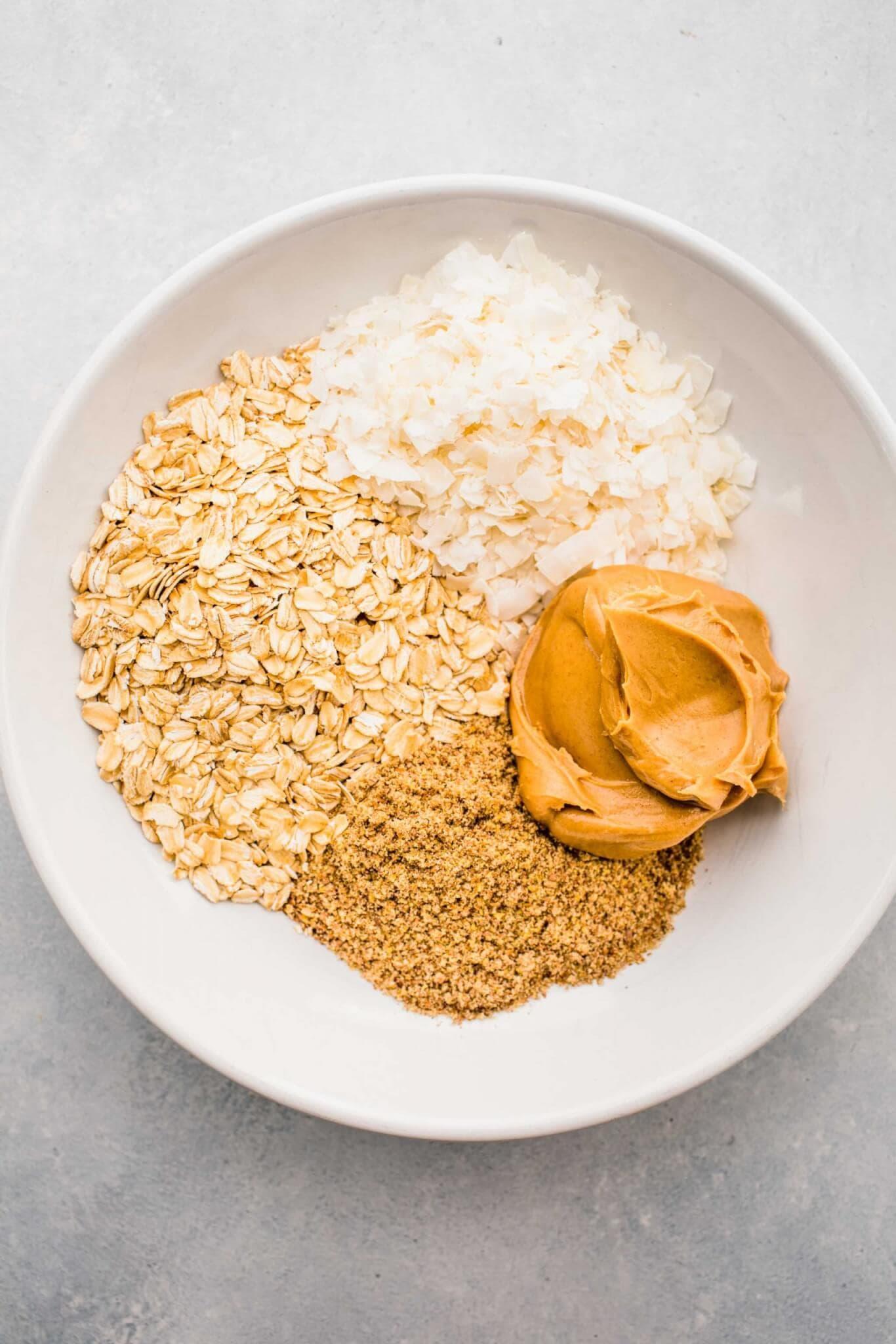 Energy bite ingredients in bowl before mixing.