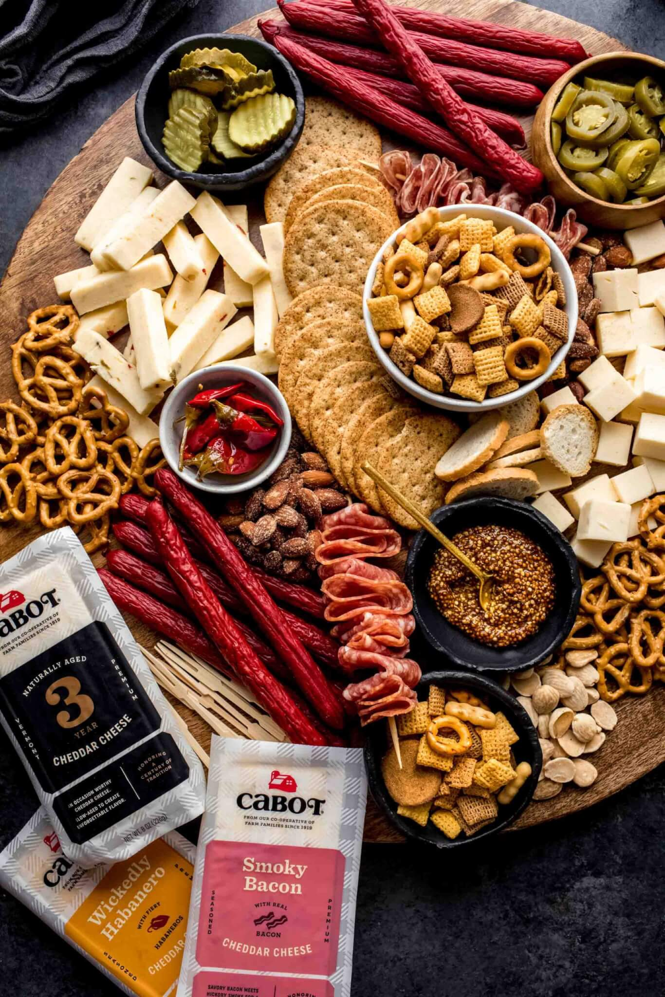 Cheeses next to game day board.