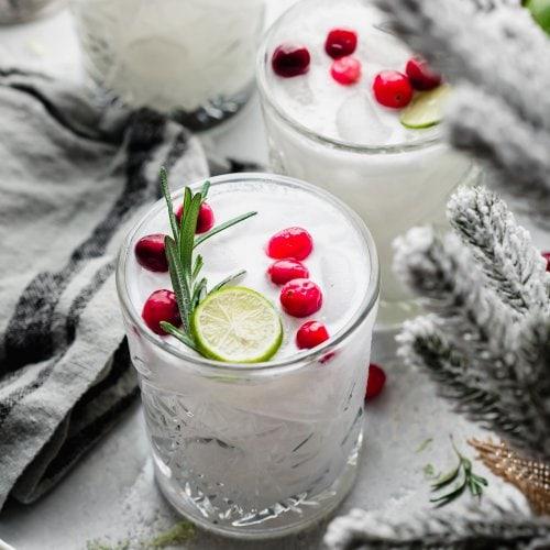 Three white Christmas Margaritas on counter with Christmas decor