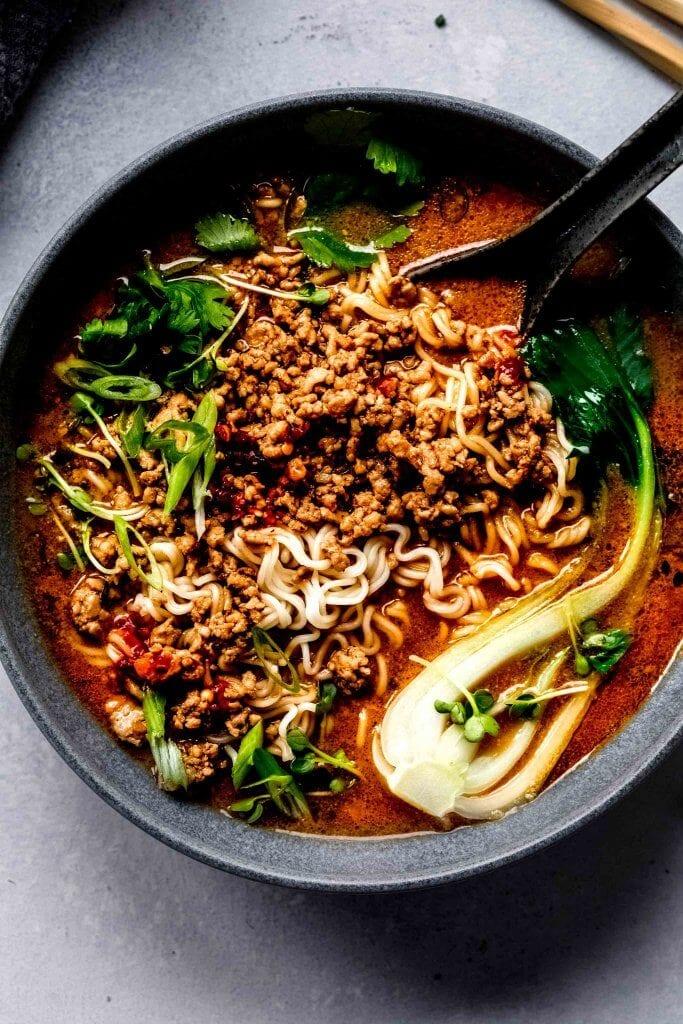 Bowl of tantanmen ramen topped with bok choy.