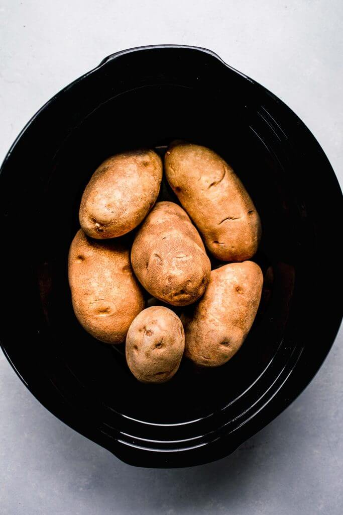 Uncooked potatoes in slow cooker.