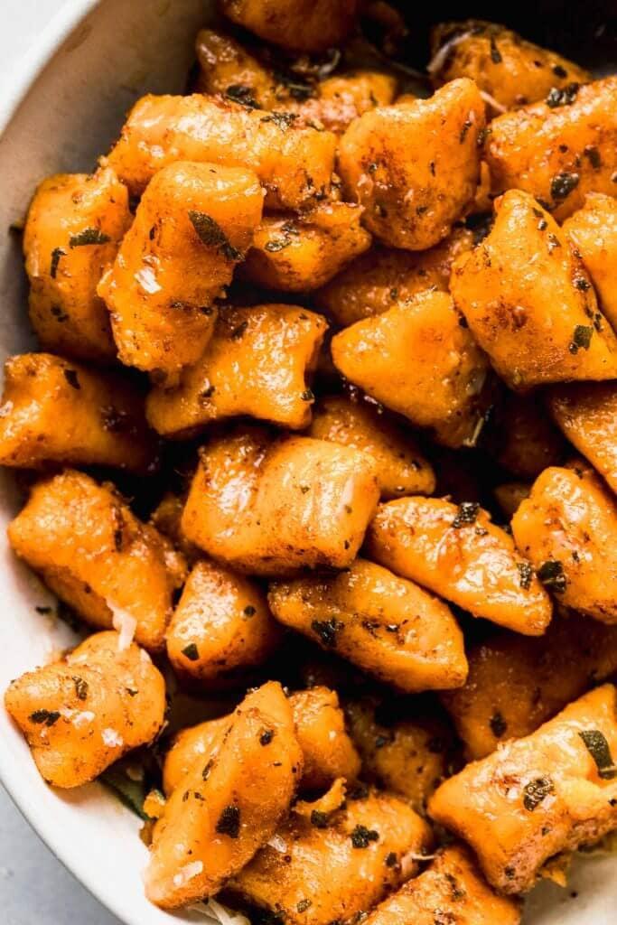 Close up of sweet potato gnocchi in bowl.