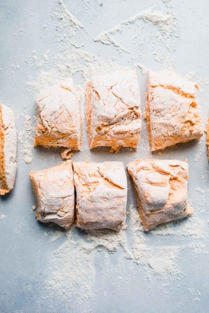 sweet potato gnocchi cut into pieces.
