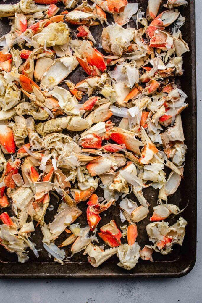 Crab shells on baking sheet.