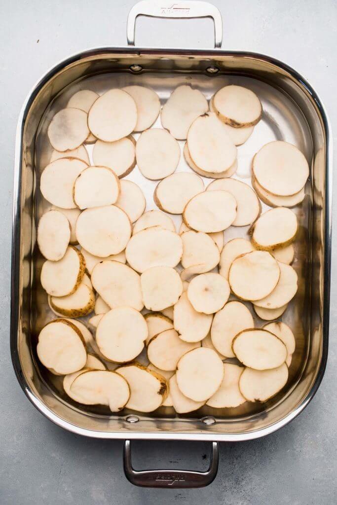 Potato slices soaking in water.
