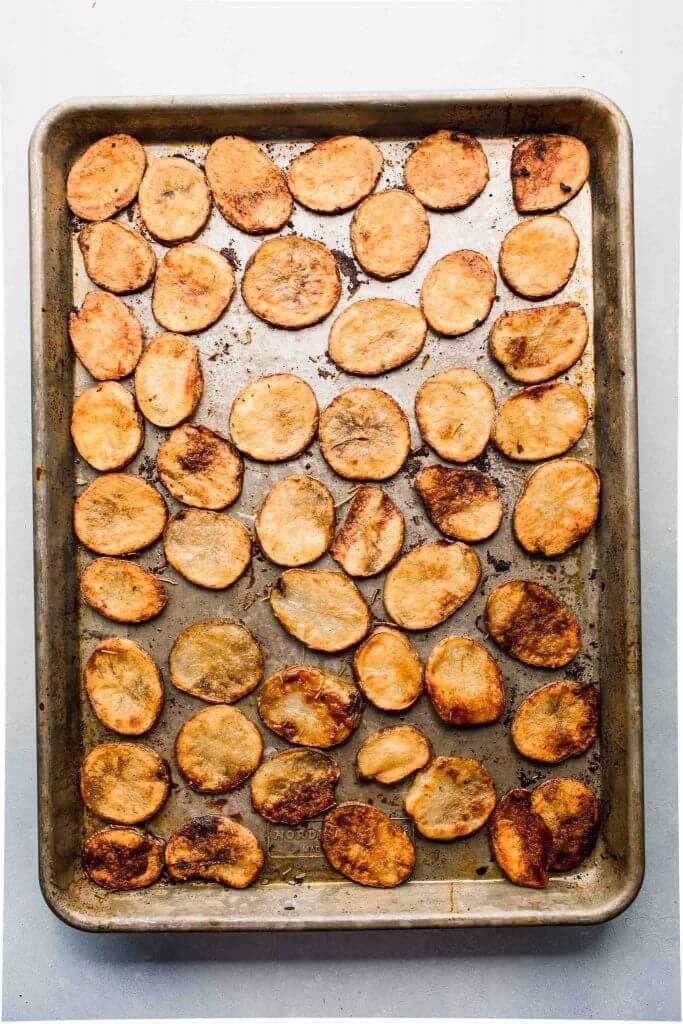 Baked potato slices on sheet pan.