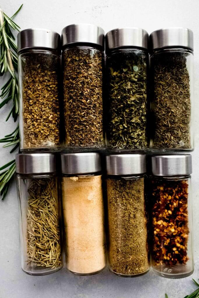 Spice jars laid out on counter.