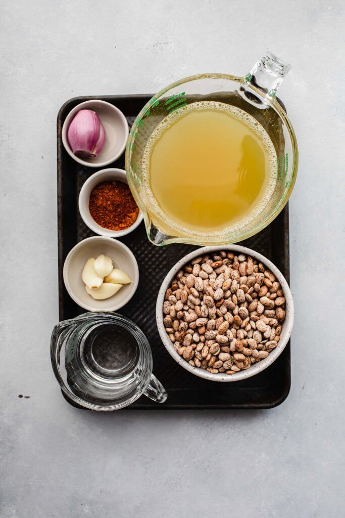 Ingredients for instant pot pinto beans on small tray.