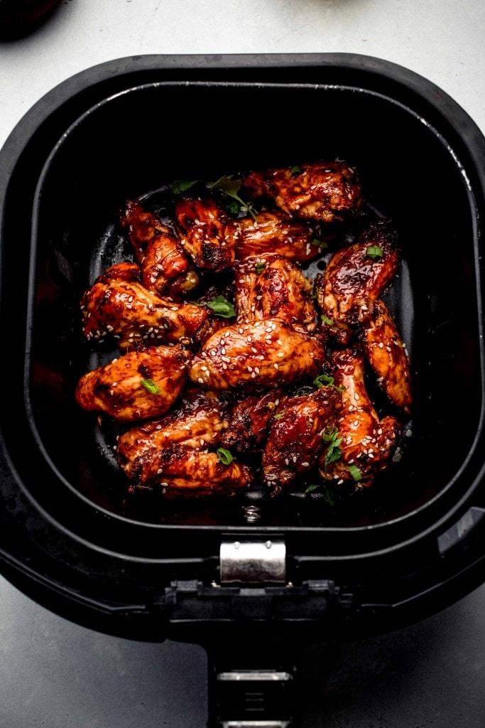 Chinese chicken wings in air fryer basket.