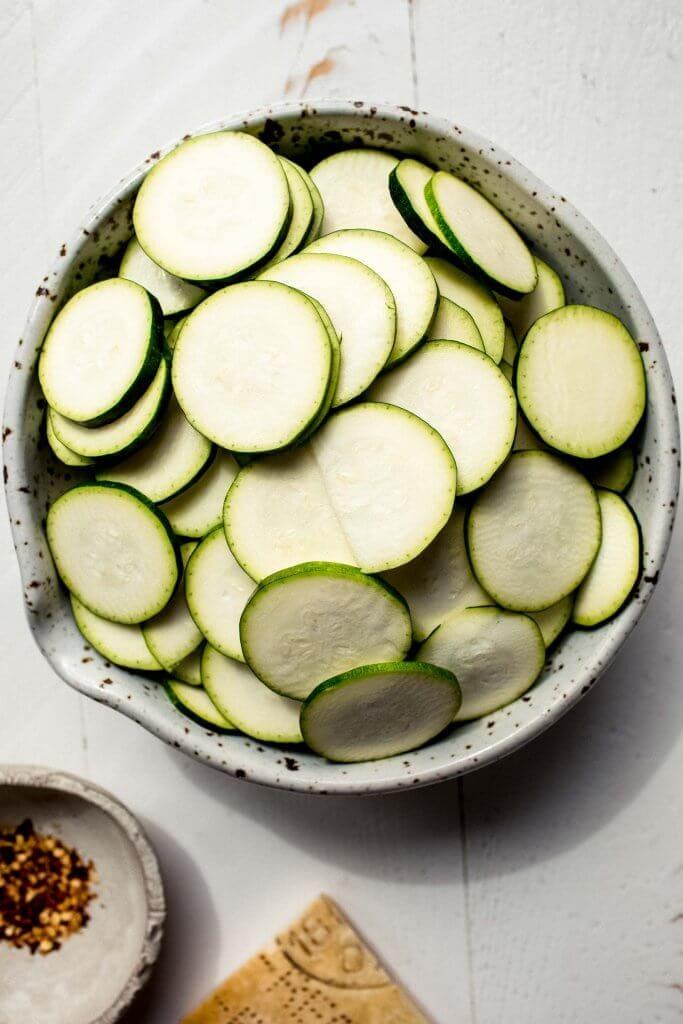 Bowl of sliced zucchini.